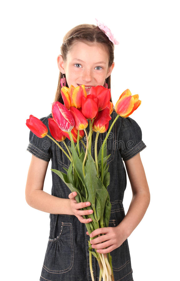 Portrait of beautiful little girl with tulips