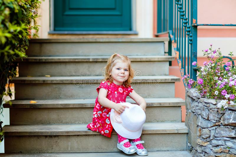 Portrait of beautiful little gorgeus lovely toddler girl in pink summer look clothes, fashion dress, knee socks and hat. Happy healthy baby child posing stock photos