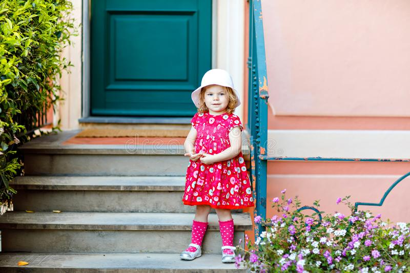 Portrait of beautiful little gorgeus lovely toddler girl in pink summer look clothes, fashion dress, knee socks and hat. Happy healthy baby child posing royalty free stock photo