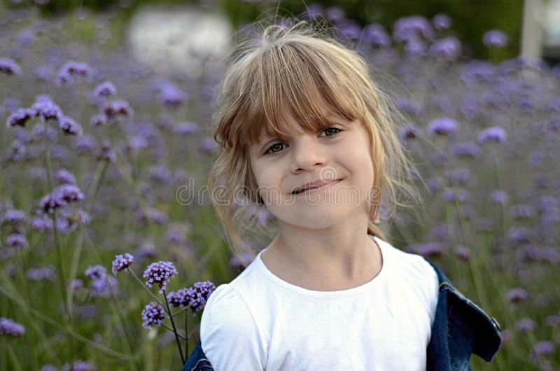 Little bright beautiful girl in white t-shirt royalty free stock photos