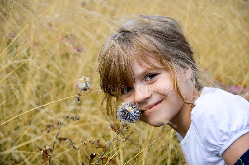 Little bright beautiful girl in white t-shirt royalty free stock photo
