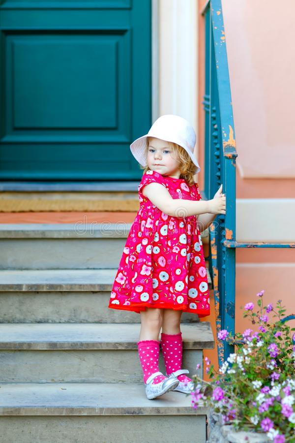 Portrait of beautiful little toddler girl in pink summer look clothes, fashion dress, knee socks and hat. Happy healthy royalty free stock photos
