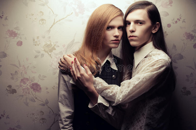 Portrait of beautiful long haired people in vintage style stock photography