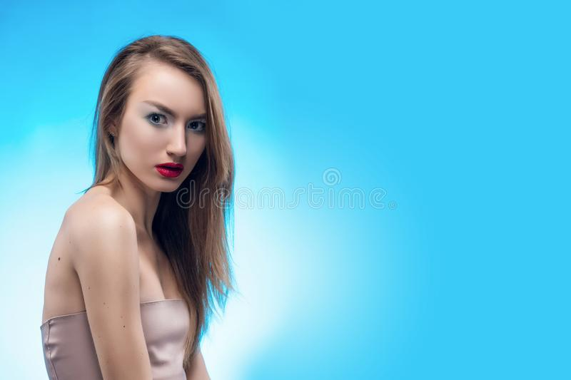 Portrait of the beautiful loocs scared blonde girl with red lips stock image