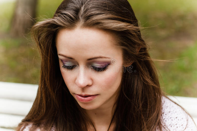 Portrait of beautiful make up of woman on white and green background royalty free stock photo