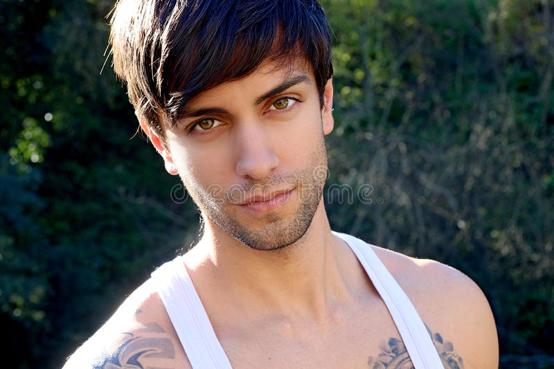 Portrait of a beautiful man with bangs. Wearing a tank top stock images