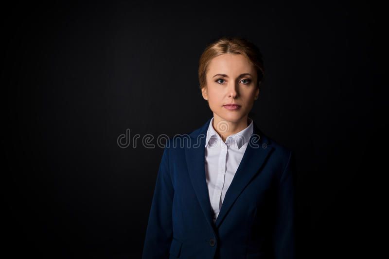 Portrait of beautiful mature businesswoman in formal wear looking at camera royalty free stock photo