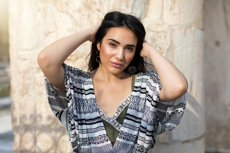 Portrait of a beautiful, mediterranean and latin looking girl royalty free stock photography