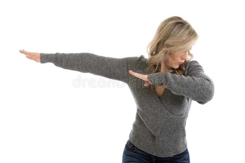 Doing the Dab. Portrait of a beautiful mid 30s woman doing the dab dance move isolated on white royalty free stock photos