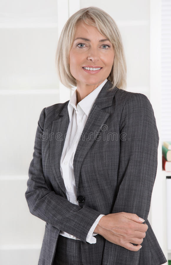 Portrait: Beautiful middle aged isolated businesswoman. royalty free stock images