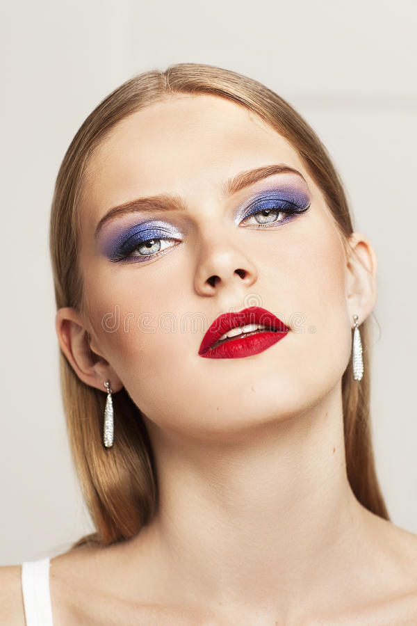 Portrait of beautiful model with evening make up. royalty free stock image
