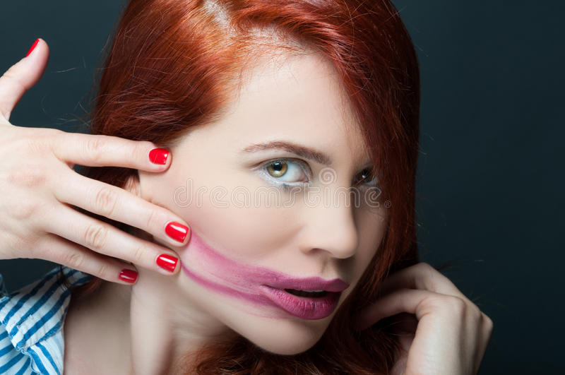 Portrait of beautiful model with smeared lipstick royalty free stock photo