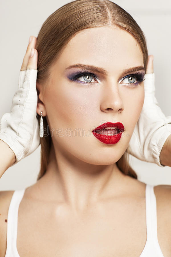 Portrait of beautiful model with surprised face wears white gloves. royalty free stock images
