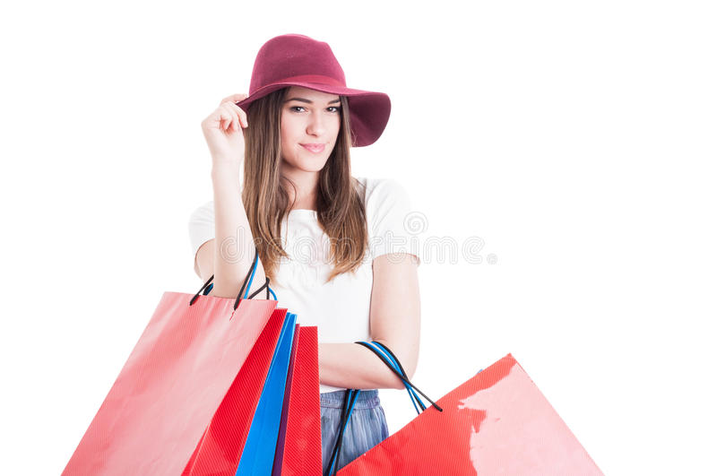 Portrait of beautiful model wearing trendy hat and doing shopping royalty free stock images