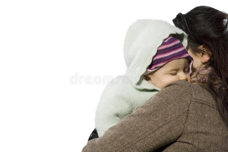 Portrait of beautiful mother holding baby girl against white background royalty free stock photography