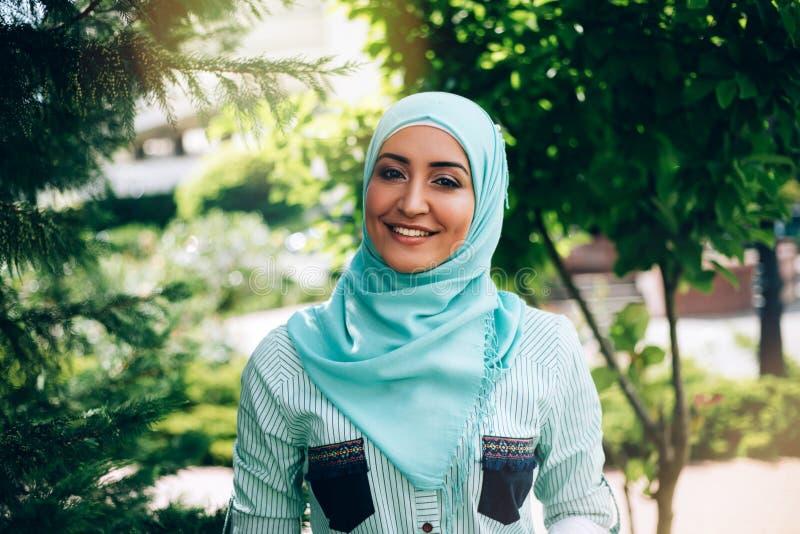 Portrait of beautiful muslim woman at street. stock photography