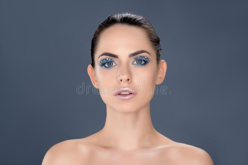 portrait of beautiful naked woman with winter makeup with glitter stock photography