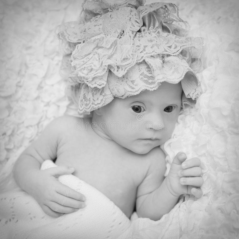 Portrait of a beautiful newborn girl with Down syndrome stock photo