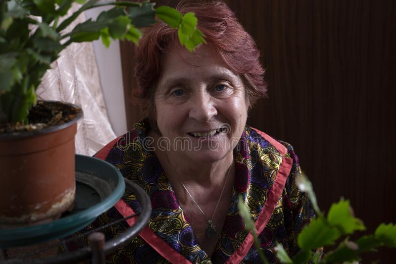 Portrait of a beautiful old woman at home stock photos