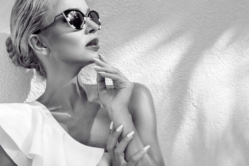 Portrait beautiful phenomenal stunning elegant blonde model woman with perfect face wearing a sunglasses. Portrait beauty stunning blonde model with perfect face stock photo