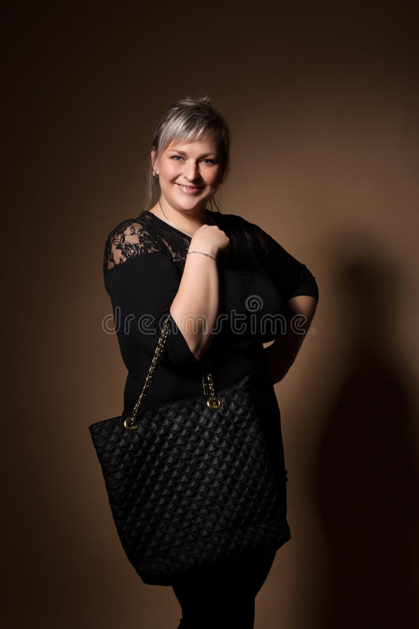 Portrait of beautiful plus size curly young blond woman royalty free stock photo