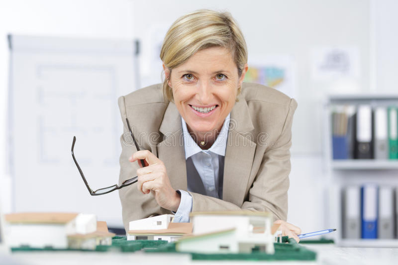 Portrait beautiful real esate agent smiling at office stock photo