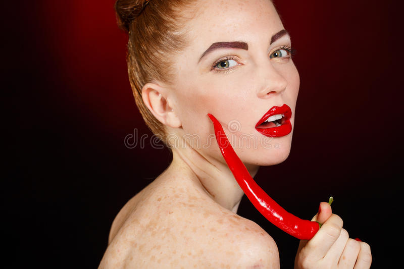 Download Portrait Of Beautiful Red-haired Woman With Red Hot Spicy Cayenne Chili Pepper Stock Image - Image of cayenne, diet: 37800431