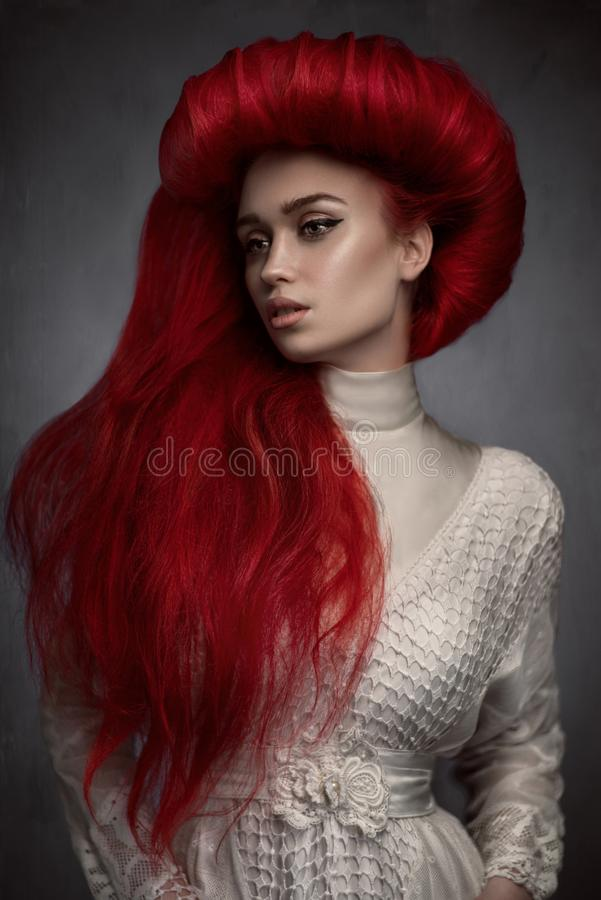 Portrait of beautiful red haired woman in white vintage dress royalty free stock photo