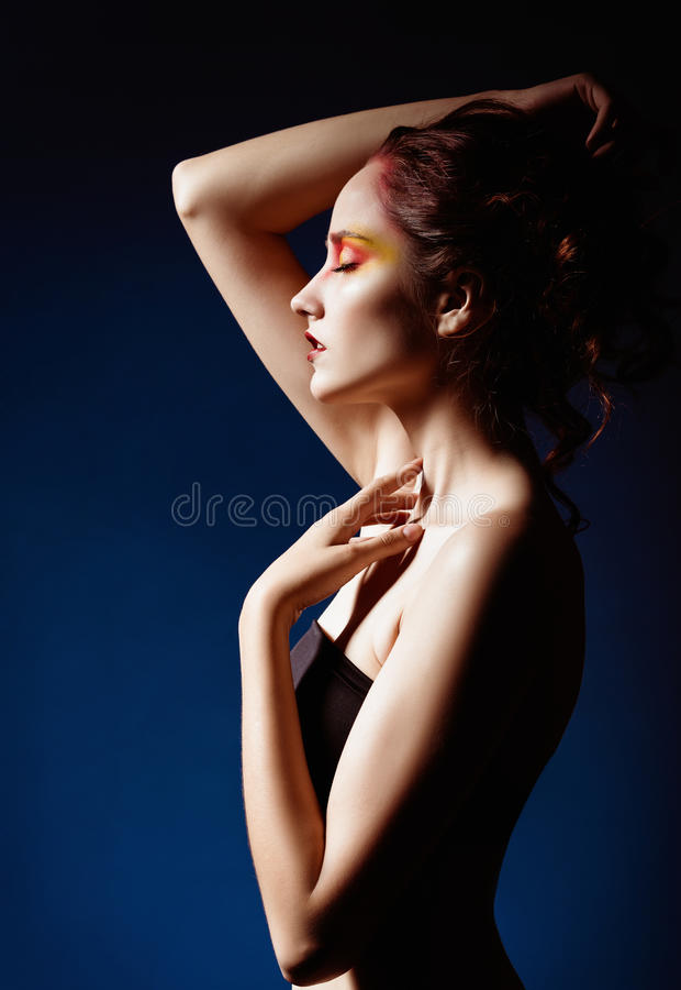 Portrait of beautiful redhead girl. Profile view stock image