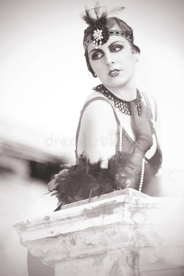 Portrait of The Beautiful Retro Woman 1920s - 1930s. Black and White Portrait of The Beautiful Retro woman in Black Lace and Accessories in Style 1920s - 1930s stock photography