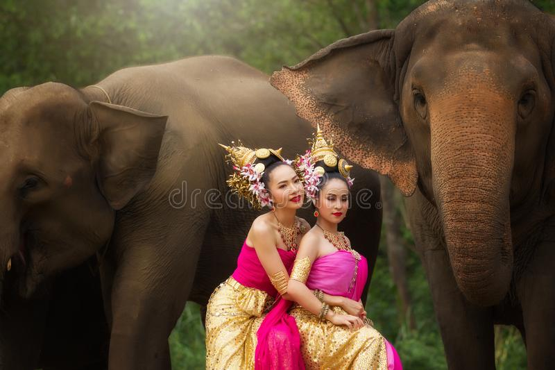 Portrait of Beautiful rural thai woman wear thai dress royalty free stock image