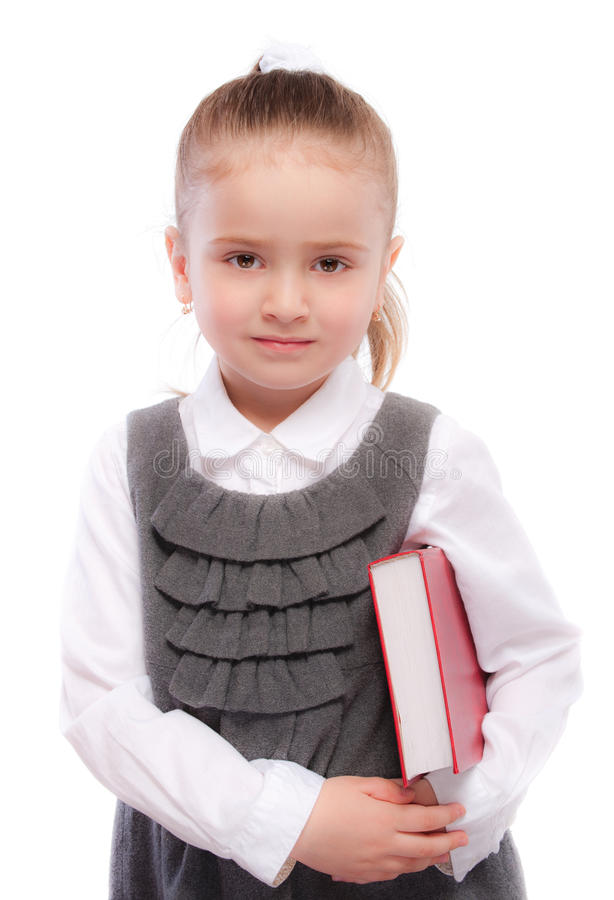 Portrait of beautiful schoolgirl with red book royalty free stock photos