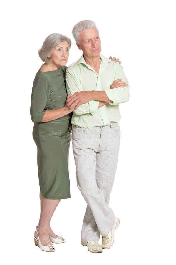 Beautiful senior couple hugging isolated on white background. Portrait of beautiful senior couple hugging isolated on white background royalty free stock images
