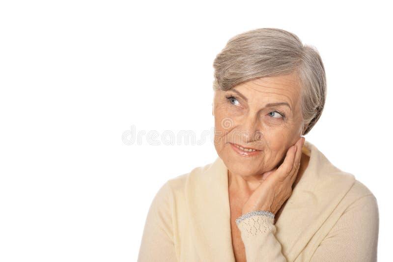 Portrait of beautiful senior woman isolated on white background stock photography