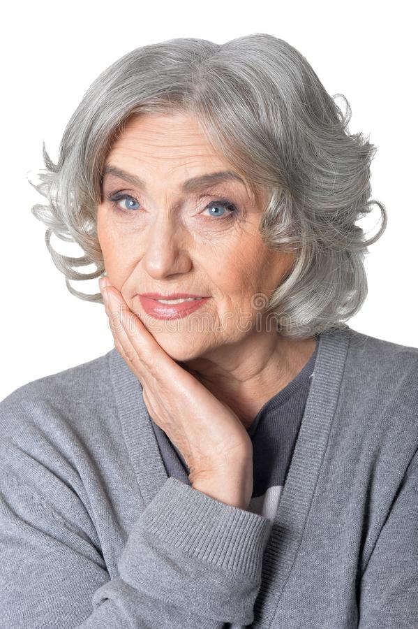 Close up portrait of senior woman, posing against white background stock images