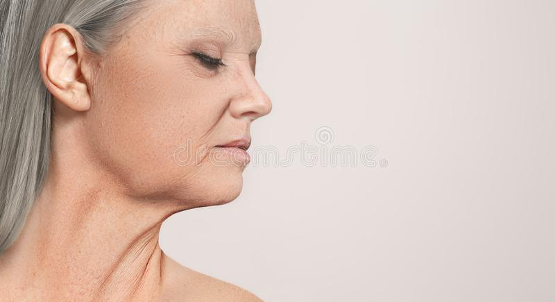 Portrait of beautiful senior woman profile view. Portrait of beautiful senior woman. The profile view at studio with closed eyes stock image
