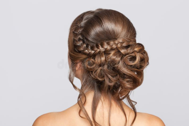 Portrait of a beautiful sensual light brown haired woman with a wedding hairstyle and nude make-up in a beauty salon. Wedding royalty free stock images