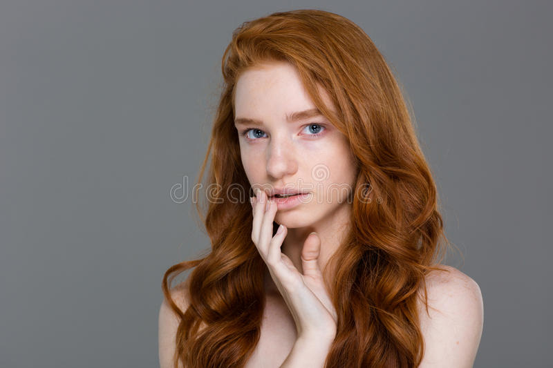 Portrait of beautiful sensual woman with curly long red hair royalty free stock photos