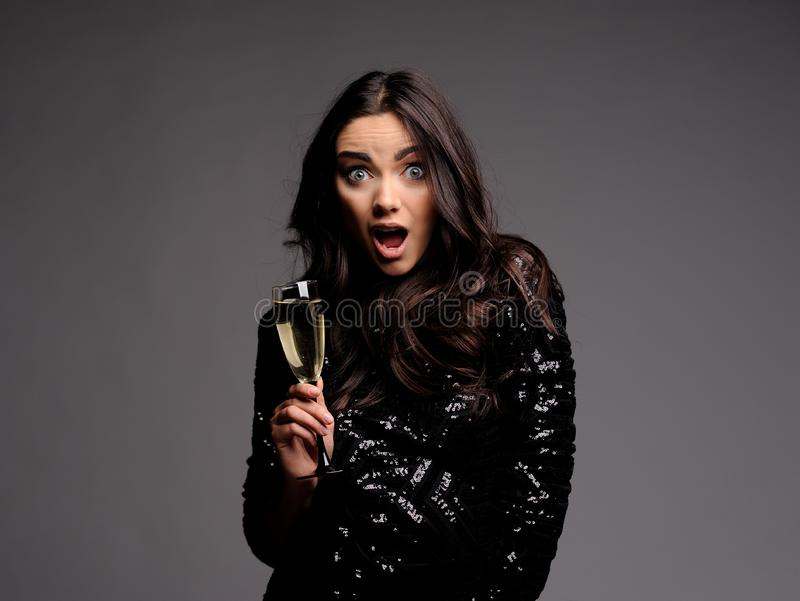 Emoyional Portrait of Beautiful Sensual Woman with glass of champagne royalty free stock images