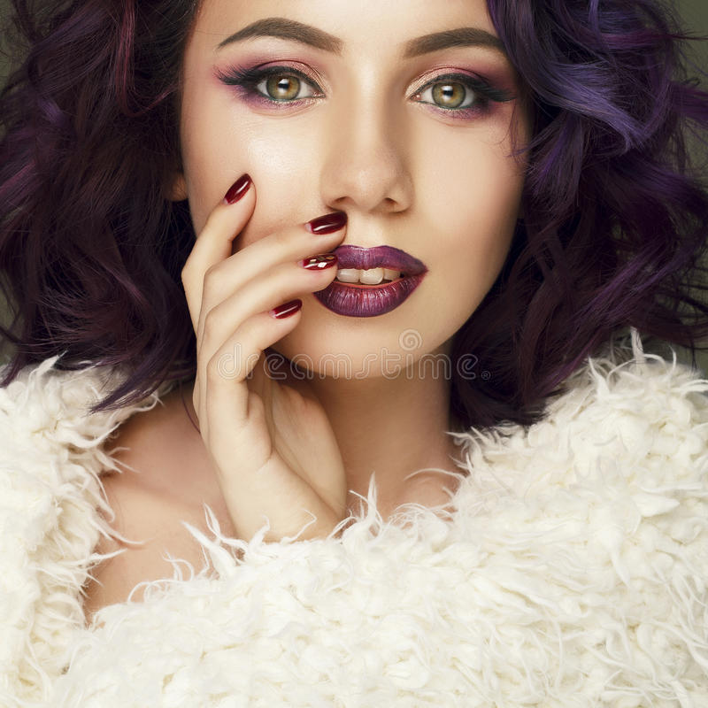 Portrait of beautiful fashion model with purple hair over g royalty free stock image