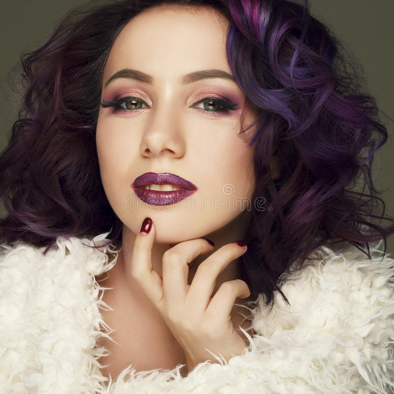Portrait of beautiful fashion model with purple hair over g royalty free stock images