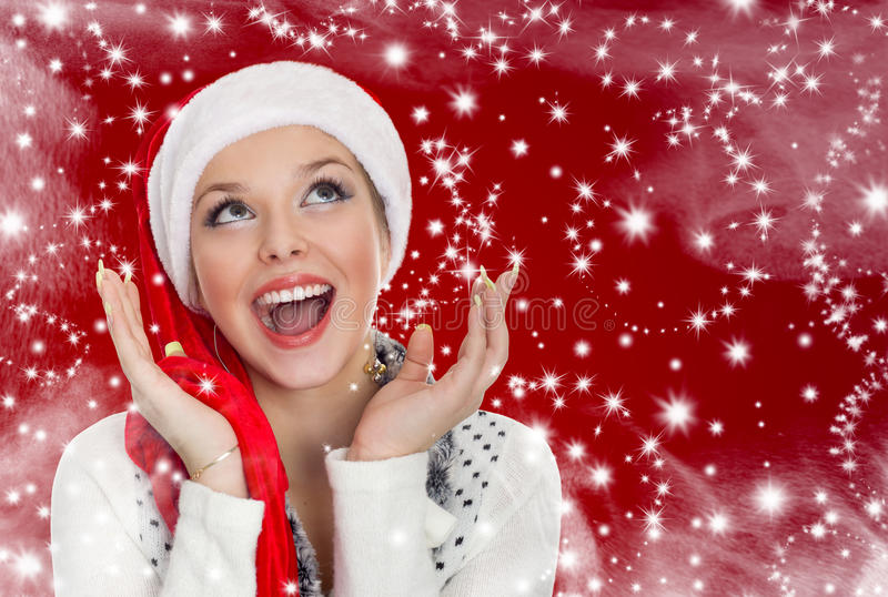 Portrait of beautiful girl in a santa hat stock photos