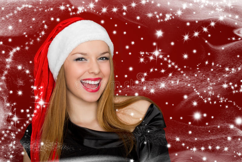 Portrait of beautiful woman in a santa hat stock images