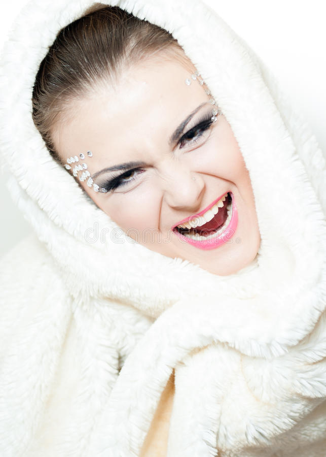 Portrait Of The Beautiful, Shouting Girl With A Fur Hood Royalty Free Stock Image