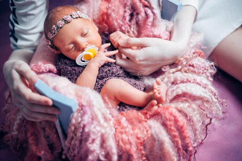 Portrait of beautiful sleeping baby in violet. Portrait of a beautiful sleeping newborn girl in violet. the concept of childhood stock images