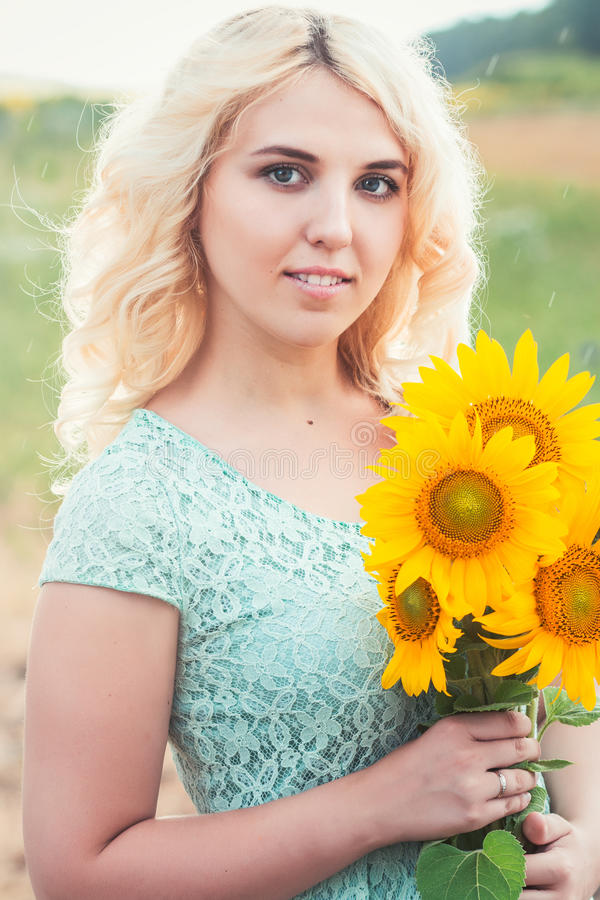 Portrait of a beautiful smiling blonde girl outdoors stock photos