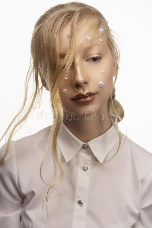 Portrait of a beautiful smiling blonde teenage girl. Conceptual stock photography