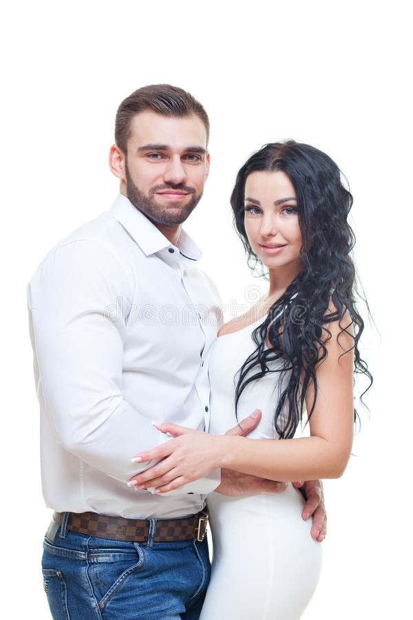 Portrait of beautiful smiling couple posing at studio over white background. valentines day theme royalty free stock photography