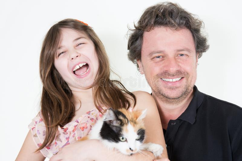 Portrait of beautiful smiling family  father daughter and cat on a white background stock photography