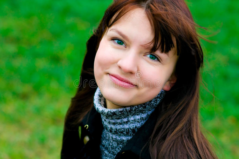 Portrait of the beautiful smiling girl royalty free stock photography
